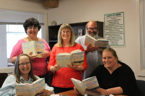 Book & Writing class with books in hand